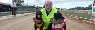 Peter Riley with celebrity greyhound Fred Bassett & VBISRace 8 VBIS distance series winner Which Wabbit